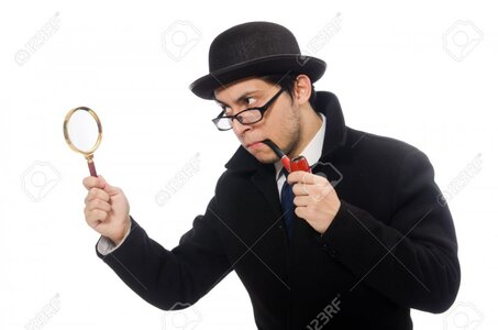 38667750-sherlock-holmes-with-magnifying-glass-isolated-on-white.jpg